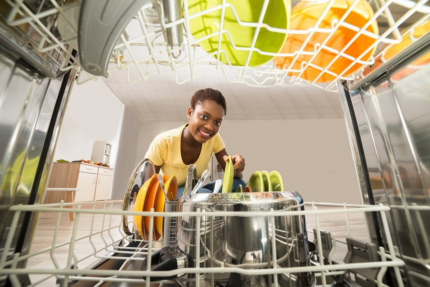 African Woman Removing Plate