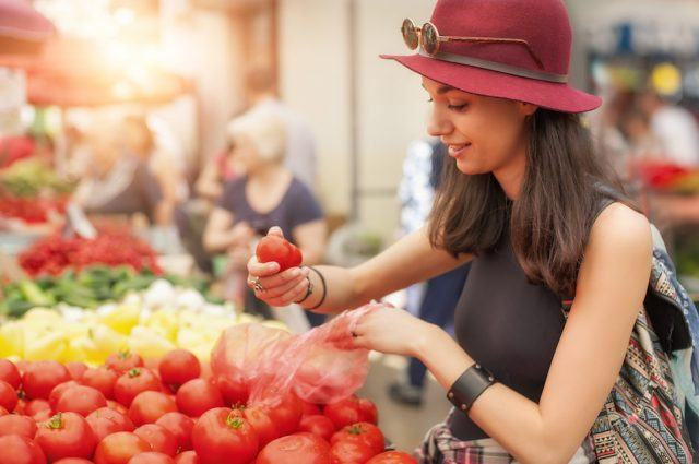 Woman at the fruit and vegetable market