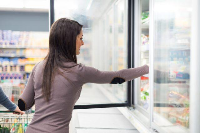 woman frozen food aisle