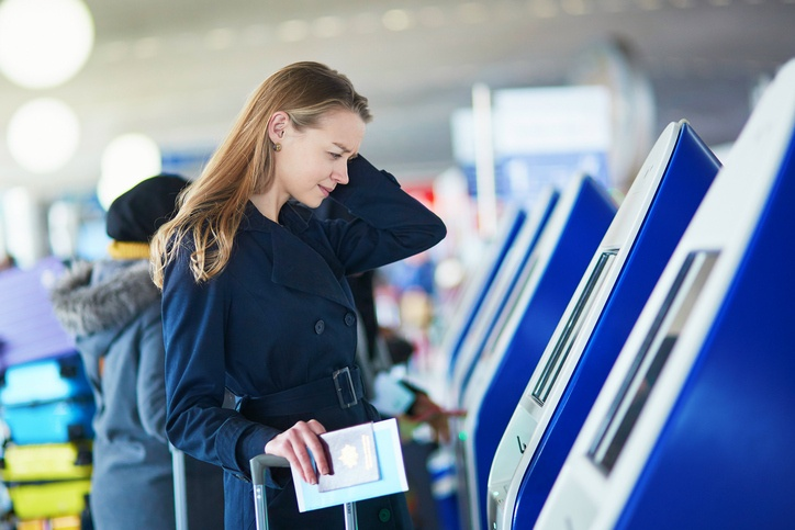 Young female traveler in international airportd