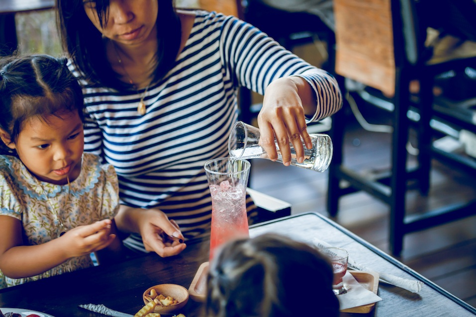 Young mother is brew drinks with daughter in cafe