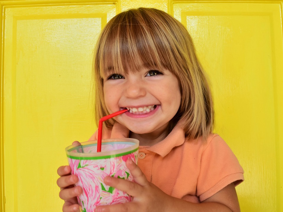 Happy child has a drink
