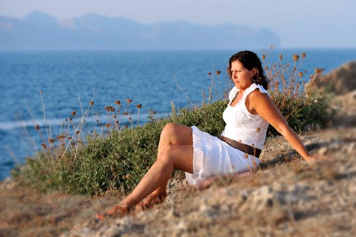 woman sitting alone on the beach