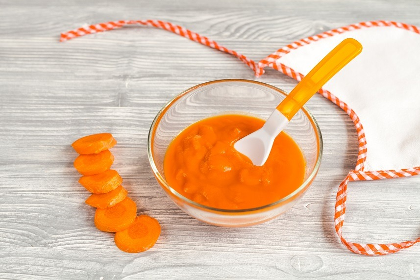 carrot puree on wooden background
