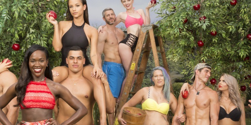 The cast of Big Brother pose in a garden of Eden.