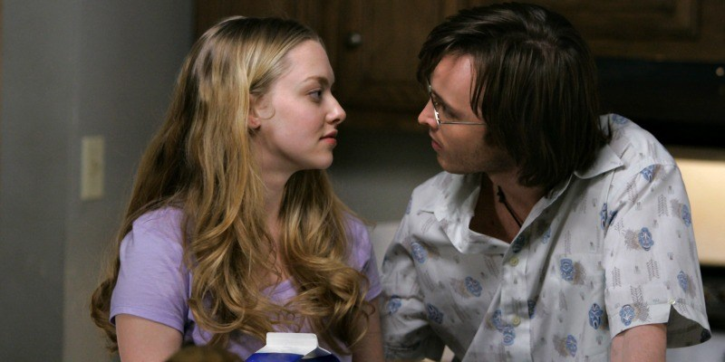 Amanda Seyfried and Aaron Paul look at each other in Big Love.