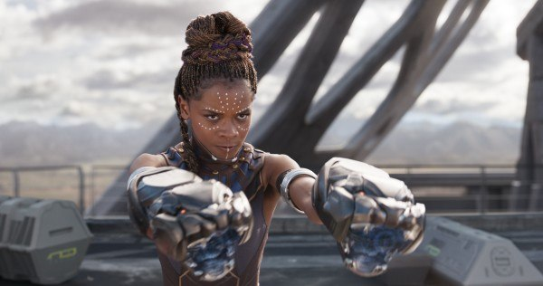 Shuri holds up her panther-shaped glove weapons in 'Black Panther'.