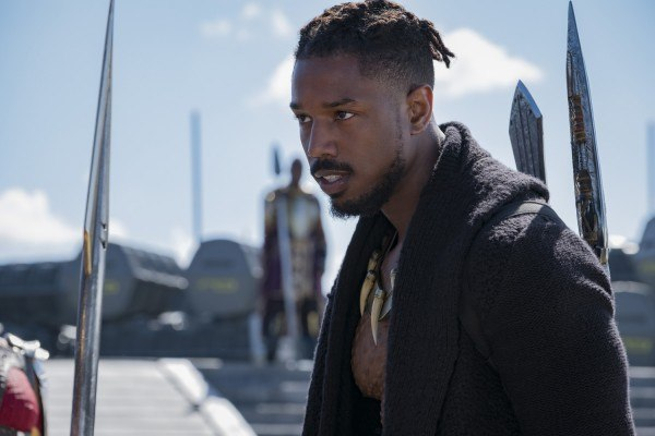 Killmonger wearing a black sweater while outside.