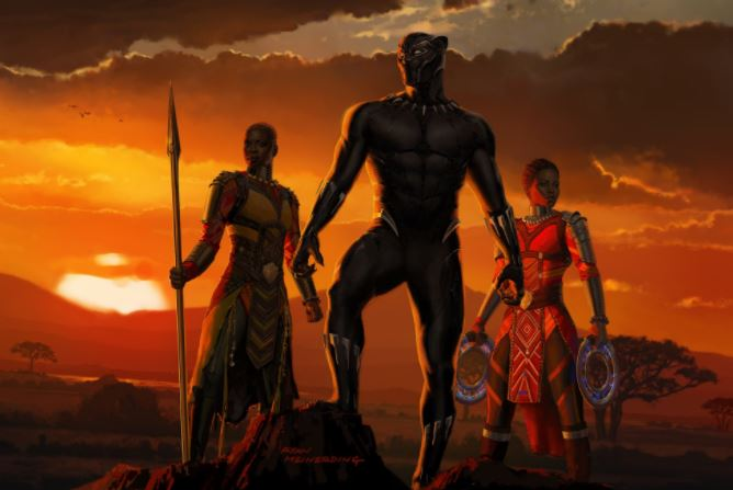 Black Panther is flanked by two female soldiers in front of a sunset
