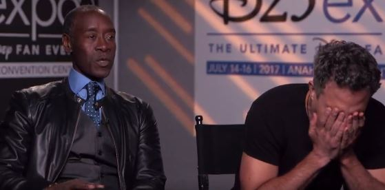 Mark Ruffalo puts his face in his hands while sitting next Don Cheadle on Good Morning America.