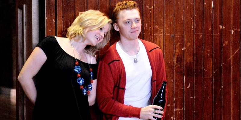 A woman leans against Rupert Grint in Cherrybomb.