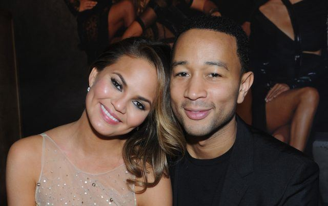 Model Chrissy Teigen and John Legend attend the Sports Illustrated Swimsuit 50 Years of Swim in NYC Celebration at the Sports Illustrated Swimsuit Beach House on February 18, 2014 in New York City.