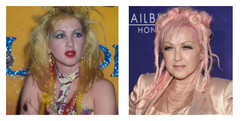 On the left is Cyndi Lauper with blonde hair and blue eye shadow. On the right is Cyndi Lauper with pink hair and a pink suit.