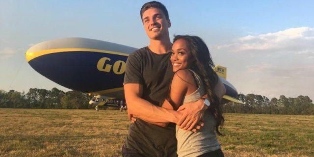 Dean Unglert is hugging Rachel Lindsay in front of a blimp.