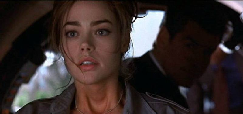 Denise Richards is looking ahead and Pierce Brosnan is behind her.