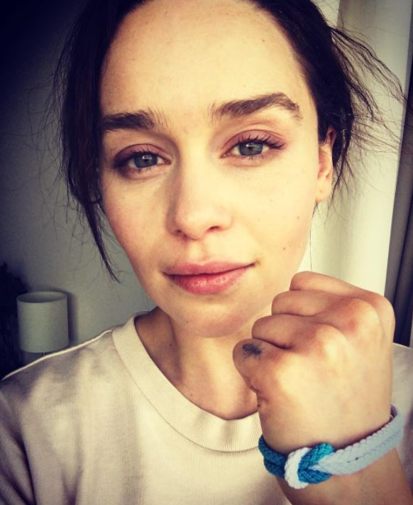 Emilia Clarke making a fist showing her Unity Band