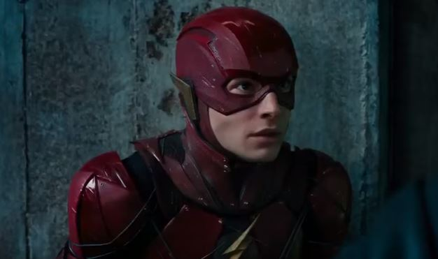 The Flash sitting down and looking at a person off-screen.