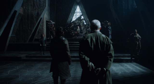 Jon Snow and Sir Davos Seaworth stand in front of Dany, who is seated in the Dragonstone throne.