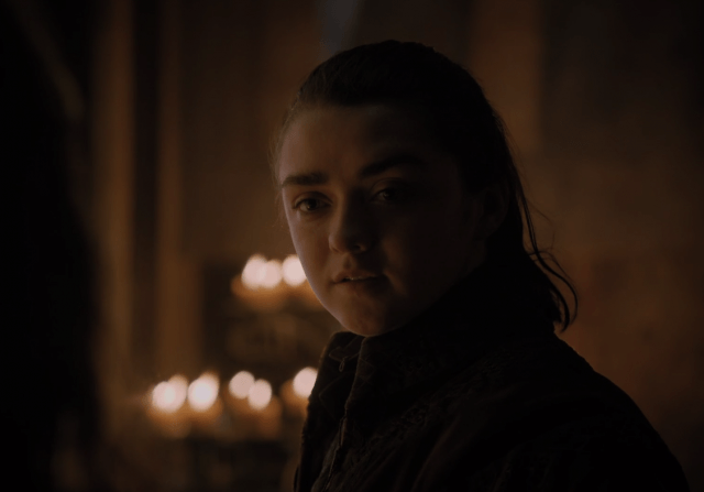 Arya Stark stands in a candlelit room in a scene from the Season 7 premiere of 'Game of Thrones.'