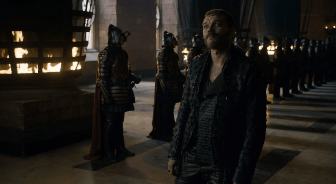 Euron Greyjoy is standing in front of the Iron Throne in Game of Thrones.