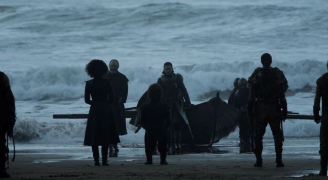 Tyrion Lannister greets Jon Snow as he disembarks his boat on the shores at Dragonstone.