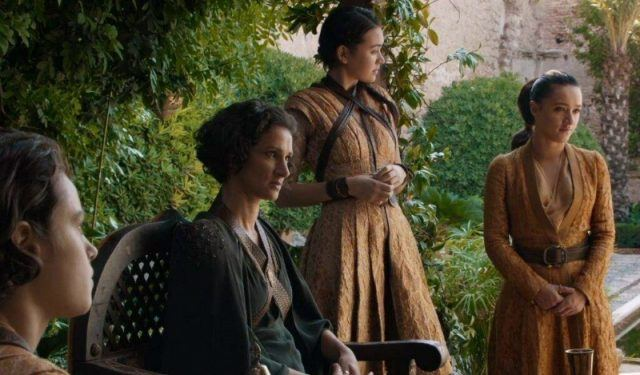 The Sand Snakes are standing together in a garden.