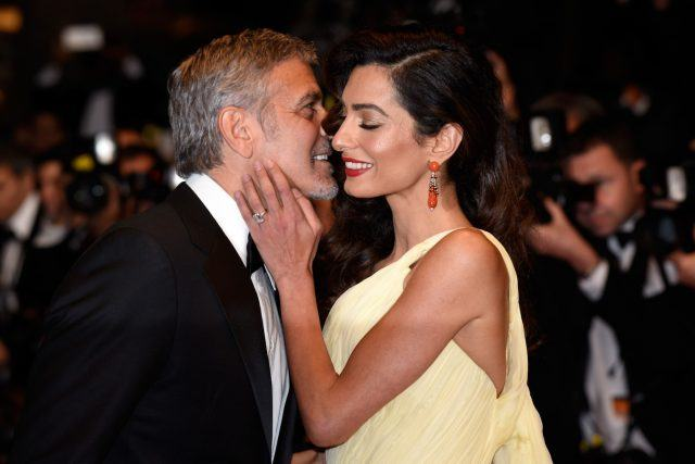 """Actor George Clooney and his wife Amal Clooney attend the """"Money Monster"""" premiere during the 69th annual Cannes Film Festival at the Palais des Festivals on May 12, 2016 in Cannes, France."""