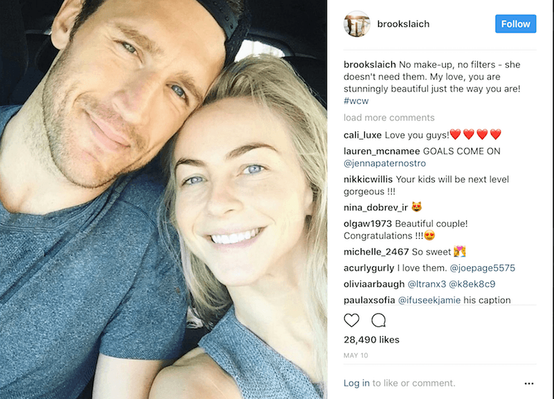 Brooks Laich and Julianne Hough lean in to each other and smile