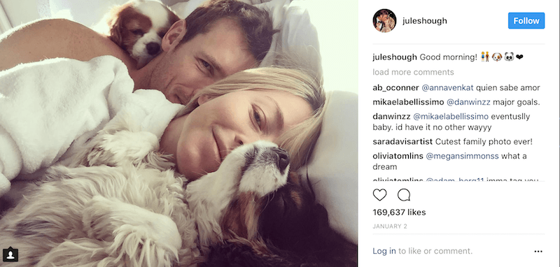 Brooks Laich and Julianne Hough lay in bed next to their two dogs