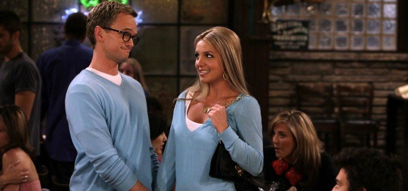 Britney Spears and Neil Patrick Harris look at each other in matching outfits.