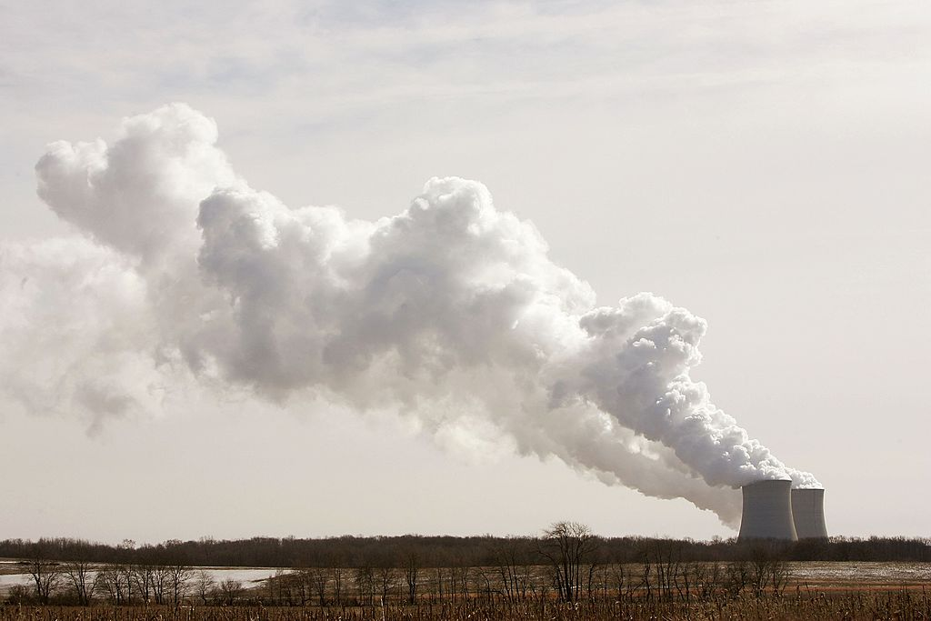 Steam billows from the cooling towers at an Illinois nuclear power plant