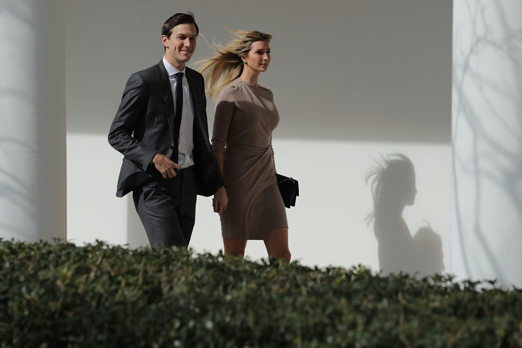 Jared Kushner and his wife, Ivanka Trump, walk down the West Wing Colonnade.