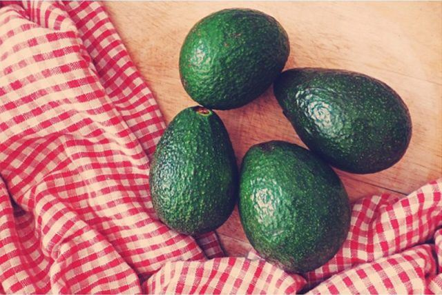 avocados on a counter