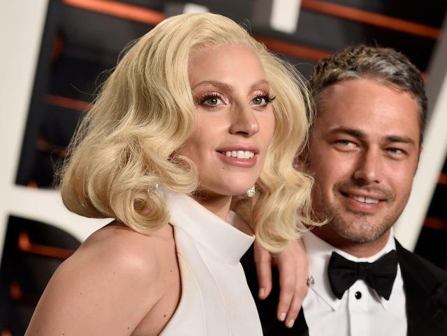 Recording artist Lady Gaga and actor Taylor Kinney attend the 2016 Vanity Fair Oscar Party Hosted By Graydon Carter at the Wallis Annenberg Center for the Performing Arts on February 28, 2016 in Beverly Hills, California.