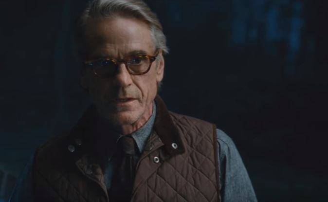 Alfred stands and looks ahead