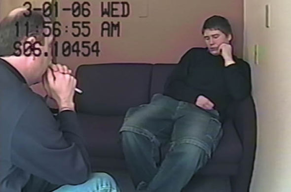 Brendan Dassey sits in a chair and is interrogated by a police officer in Making a Murderer