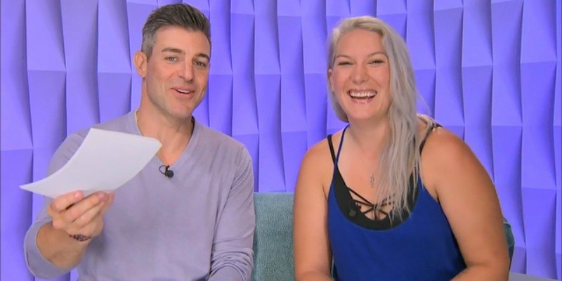 Megan Lowder talks to a man in the diary room of Big Brother.