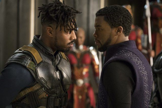 Michael B. Jordan as Killmonger stares down Chadwick Boseman as T'Challa in Black Panther.