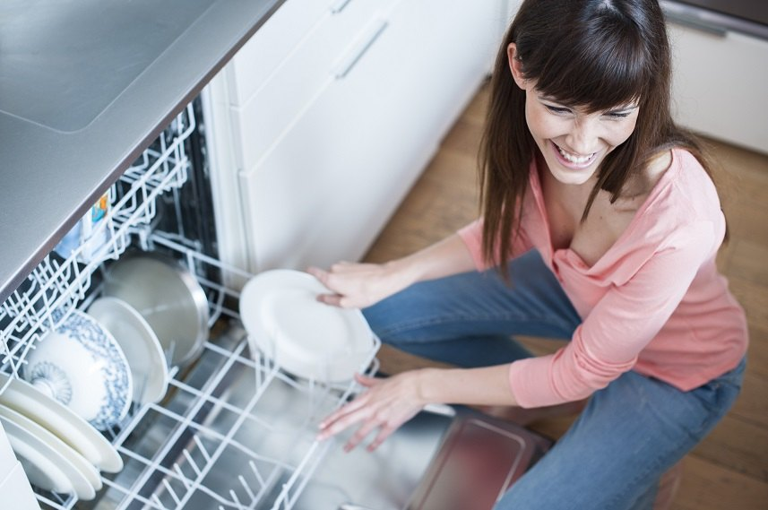 young woman in kitchen doing housework