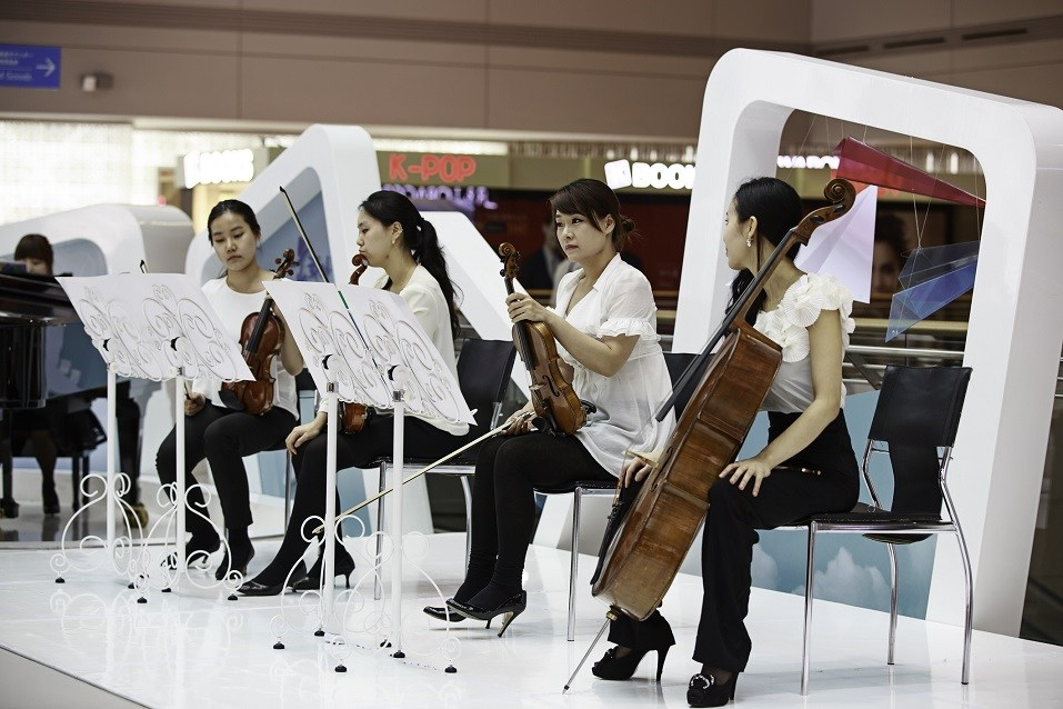 Group of musicians performing at Incheon International Airport