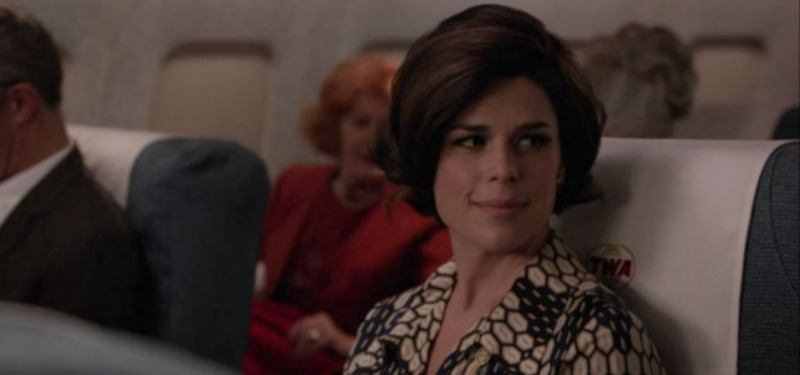 Neve Campbell sits on an airplane in Mad Men