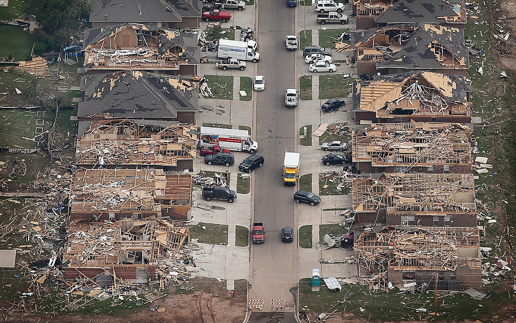 Homes damaged and destroyed by a tornado line a street in Moore, Oklahoma