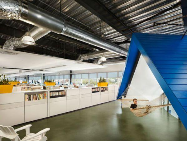 employee working in hammock at Home Away office in Austin