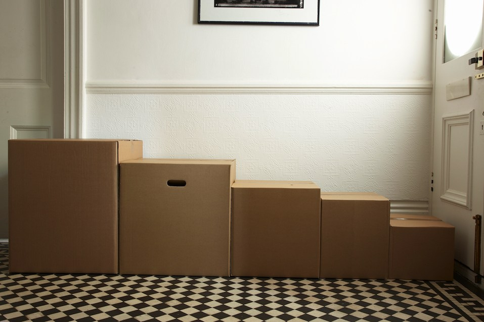 packing boxes in order of size in hallway