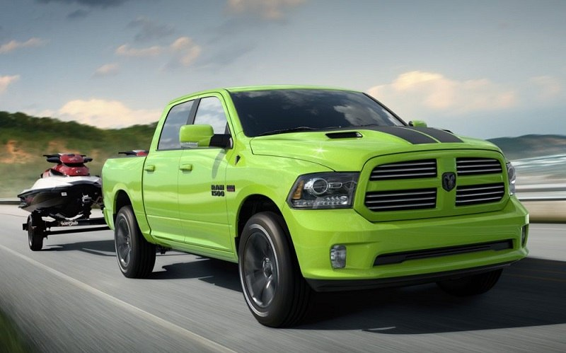 A sublime green Ram 1500 Sport seen towing a jet ski on the highway