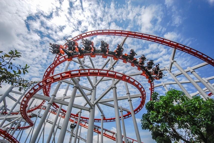Dreamworld amusement park with roller coaster