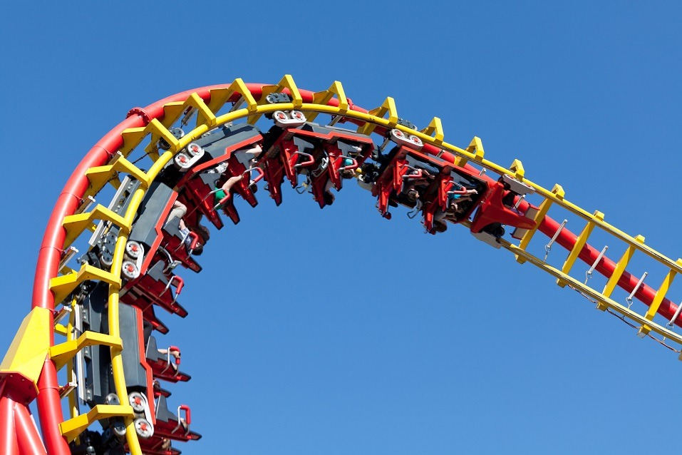 rollercoaster against blue sky