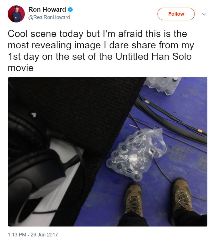 "An image of shoes, water bottles, and film equipment from above with the text ""Cool scene today but I'm afraid this is the most revealing image I dare share from my 1st day on the set of the Untitled Han Solo movie"" from @RealRonHoward"