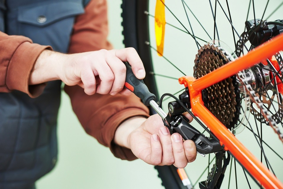 Serviceman installing assembling or adjusting bicycle gear