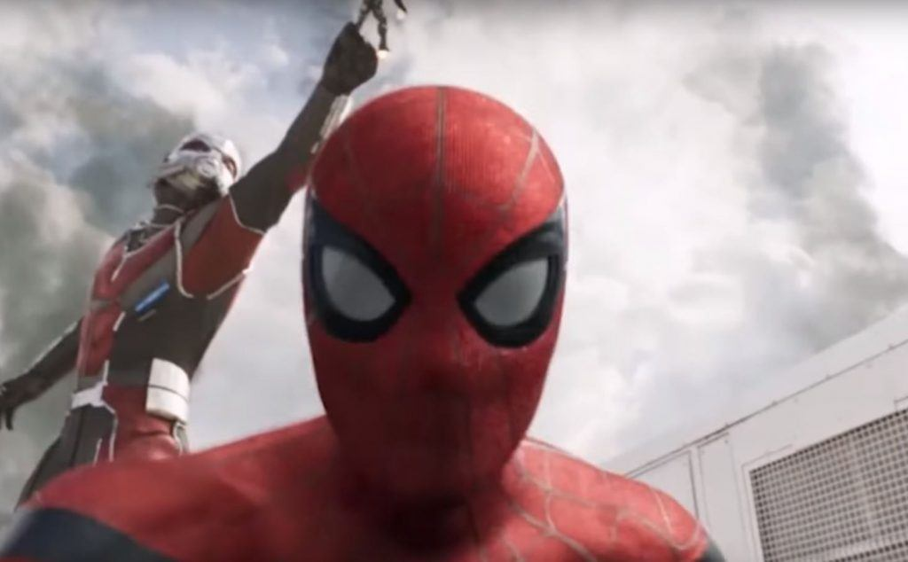 Spider-Man staring into the camera with Giant-Man behind him